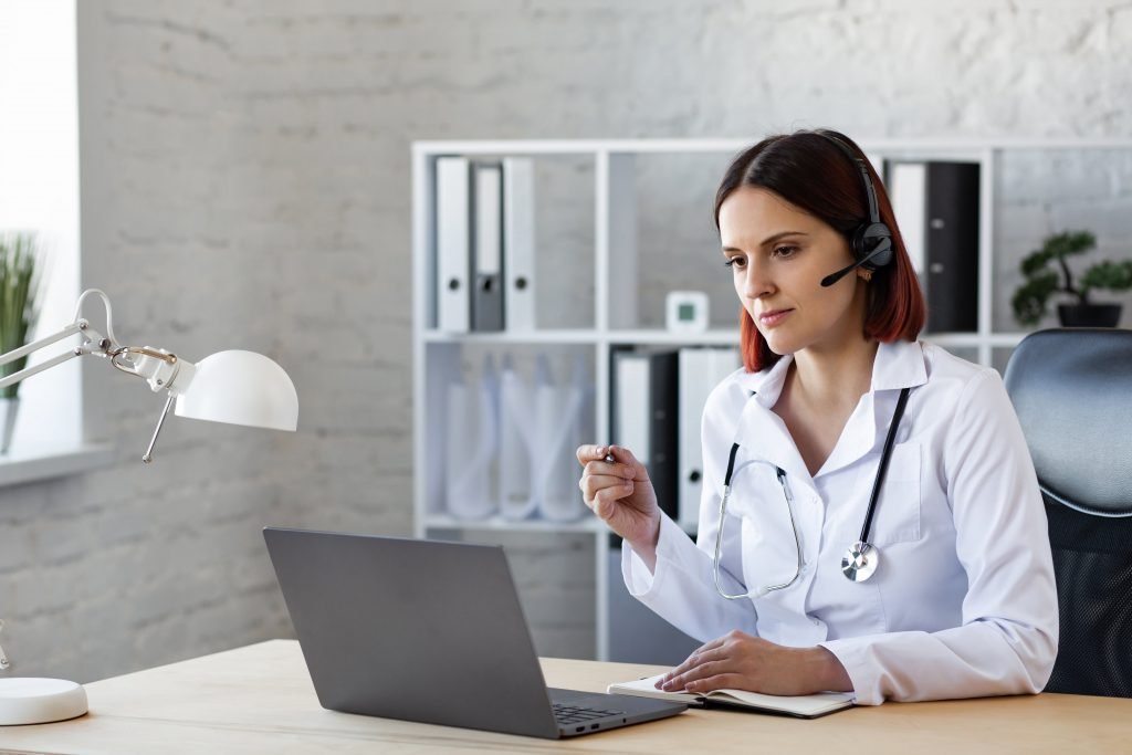 woman doctor consults by video call online medical assistance
